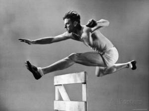 gjon-mili-star-hurdler-jim-humphrey-showing-off-his-high-hurdle-form